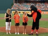 Gigi Sellers high-fives the Orioles mascot during the Passing of the Baton of Patriotism ceremony.